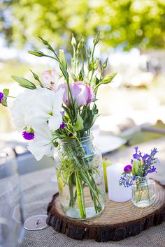 Lisianthuses in mason jars are a fresh, pretty centerpiece   Brides.com