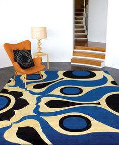 Rug by Cadrys: Based on wallpaper by Florence Broadhurst  http://www.florencerugs.com.au/content_common/pr-solar_saffron-navy-wool-silk-150knot.seo