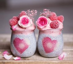 Chia pudding jars with a strawberry smoothie topping.