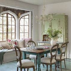 The aged-to-perfection dining table in a vivid aqua hue and the stunning sage cupboard give the dining room old-school charm.  > http://wayfair.ly/1gR8GAY