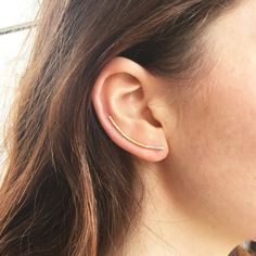 Simple, elegant, but cutting edge! These minimalist sleek ear climbers hook in like bobby pins so the ear wire backing hugs the behind the ear,