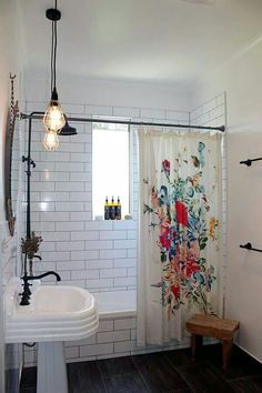 Love this bathroom design with white subway tile, pendant lighting, pedestal sink and beautiful splash of colour in the shower curtain - art can be anything