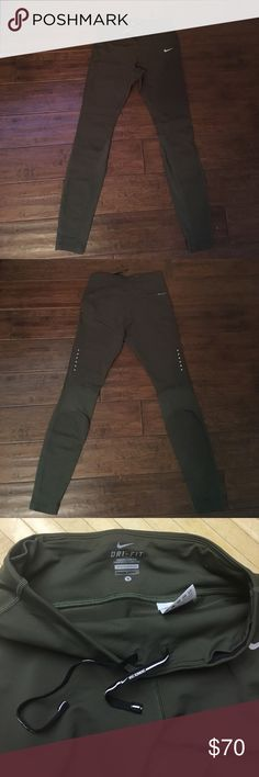 """Nike Leggings worn once. washed once. reflective details (logo on front and dots on back). mesh at bottom. Inseam is 28"""" Nike Pants Leggings"""