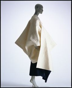 Rei Kawakubo (b1942) is a Japanese fashion designer, founder of Comme des Garçons. She is an untrained fashion designer, but studied fine arts and literature. Comme des Garçons specialises in anti-fashion, austere, sometimes deconstructed garments. During the 1980s, her garments were primarily in black, dark grey or white.