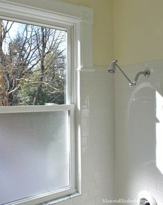 Our old-house bathroom has a giant window in the shower... See our DIY solution!