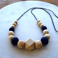 """Teething Necklace  //  Check it out on www.zieandme.com.au  //  Zie + Me's """"Mackenzie"""" necklace makes a gorgeous statement, made with a feature 20mm wooden hexagon and a mixture of silicone and wooden round beads ranging from 12mm-20mm.  Zie + Me uses 100% non-toxic silicone beads that are free of BPA, phthalates, cadmium, lead and metals. They will not absorb odours or support the growth of mould. Our wooden beads are non-toxic, raw, untreated maple. #teethingnecklace #teethingjewellery"""
