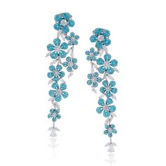 These extraordinary earrings contain 4.42 ctw of bright blue paraiba tourmaline set into 18k white gold flowers. This rare gem is accentuated by .88 ctw of round diamonds, .54 ctw of pear shaped diamonds, 2.16 ctw of marquise shaped diamonds. Print Page