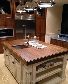 Walnut Wood Kitchen Island Countertop, cream color cabinets under, dark wood wall cabinets. The blue countertop needs to be a cream colored granit (NOT blue anything lol)
