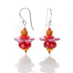 Image of stacked bead earrings - pink & orange by Stephanie Sersich. I really admire her control of soft glass, and her use of bright, cheerful colors is amazing.
