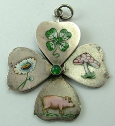 Victorian silver and enamel fold out lucky clover charm.  Sandys Vintage Charms