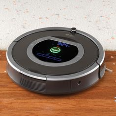 """The Dirt Detecting Robotic Vacuum - Hammacher Schlemmer - """"It was amazing how it maneuvered around the bedroom furniture and it seemed to cover every square inch of our entire upstairs without missing anything."""""""