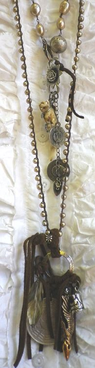 Long pearl necklace with suede ties and extra large coin.