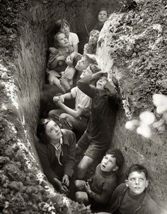 English children waiting out an air raid. England 1940.