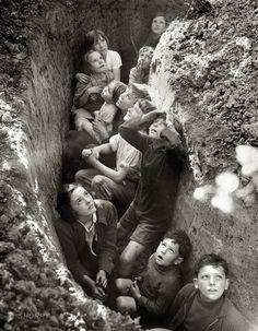 English children waiting out an air raid. England 1940.