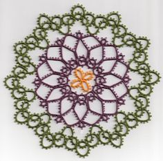"""Sunflower -- From Blomqvist and Persson's book, 'Tatting Patterns and Designs'.  I used Lizbeth 20 threads, approximately 7"""" across."""