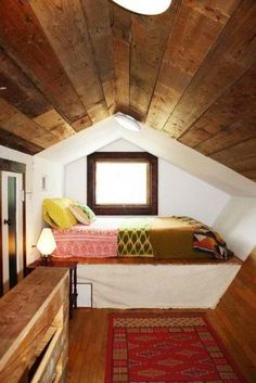 Erin's Warm & Wood-Wrapped Austin Bungalow on a Budget. This would be cool in one of the tiny home lofts for the kids. Use as a day bed. Pull out bed underneath, then cover again with long bed skirt. Attic Bedrooms, Home Bedroom, Bedroom Nook, Design Bedroom, Bedroom Decor, Bedroom Ideas, Dream Bedroom, Attic Design, Bungalow Bedroom