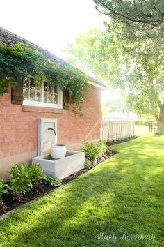 Backyard Landscaping BEFORE! #backyardlandscaping #DIY #landscaping #beforeandafter #fountain #backyardfountain #backyardideas #vigoro #ad