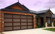 Our Ultimate Sectional Garage Doors are all about flaunting absolute street appeal. Create a custom design to suit your taste and budget. Centurion's Ultimate Range doors are each distinctive in their own right. Take a look! Custom Garage Doors, Garage Door Design, Custom Garages, Sectional Garage Doors, Laser Cut Panels, Restoration, Custom Design, Outdoor Decor