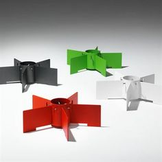 Turbin Christmas tree stand from SMD Design is available in white or red, and is made of lacquered steel. Can be used both indoors and outdoors.