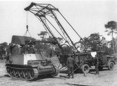 A (SdKfz 132) Marder 2 getting a new gun assembly installed