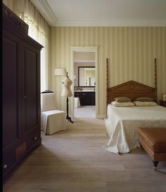 The vertically striped wall covering gives this room a timeless feel