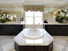 A wide-decked floating tub, flanked by two matching vanities, highlights this master bath. Bathroom Trends, Bathroom Sets, White Bathroom, Bathroom Interior, Bathroom Vanities, Bathroom Remodeling, Ideal Bathrooms, Beautiful Bathrooms, Master Bathrooms
