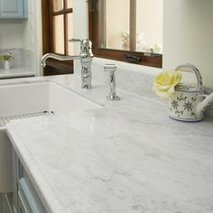 Marble countertops are really popular these days! Bianco Carrara from arizonatile.com is a lovely white marble for this classic kitchen counter.
