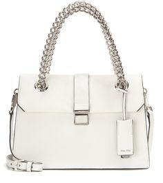 Miu Miu - Leather shoulder bag - Miu Miu's leather shoulder bag is one you are sure to treasure for seasons to come. Crafted from grainy white leather with bright silver-tone hardware accents, this piece is deceptively roomy with two suede-lined compartments to keep you organized. Carry yours over your shoulder from dinner dates to casual weekends. seen @ www.mytheresa.com
