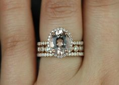 Middle band and stone as the engagement ring... outer bands as the wedding ring... LOVE IT