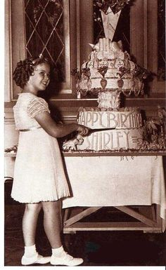Shirley Temple and her birthday cake.