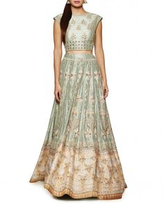 Sage green lengha with resham embroidery comprising a sage green choli with leaf motifs detailed with gota patti and dori work. Featuring a boat neckline with princess panel design. Cap sleeves.