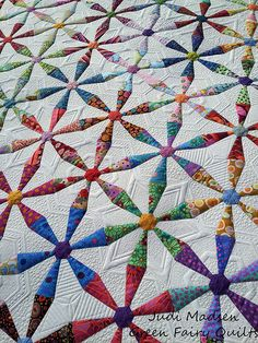 Spring Wheels quilted by Judi Madsen of Green Fairy Quilts.  Love this!