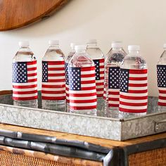 of July Water Bottles One incredibly simple way to add a little of July spirit? Wrap small flags around water bottles. Cheap plastic or fabric flags work best -- paper flags would wither as the water condenses. Fourth Of July Decor, 4th Of July Celebration, 4th Of July Decorations, 4th Of July Party, July 4th, Easy Decorations, Holiday Decorations, Seasonal Decor, Happy Birthday America