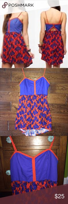 """Urban Outfitters Linen Blend, Never Worn, Dress Never worn! Cobalt blue and reddish orange colors. Skirt hem goes slightly lower in back. Two snap open keyhole back. Adjustable spaghetti straps. Linen/cotton blend. Top is fully lined. I bought this dress, threw away tags, And have never worn it. However, in looking it over for PM, I noticed two """"flaws."""" See the last two photos. There is a small pull on right side of Bust, and there is a small white line on skirt. Urban Outfitters Dresses"""
