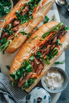 Turn your leftover Easter ham into a Vietnamese favorite with this fast flavorful ham banh mi sandwich youll want for lunch every day! A quick pickle recipe is included so you can recreate that authentic taste in your own kitchen. Banh Mi Sandwich, Sandwich Recipes, Pork Recipes, Asian Recipes, Ethnic Recipes, Best Sandwich, Quick Pickle Recipe, Banh Mi Recipe, Leftover Ham Recipes
