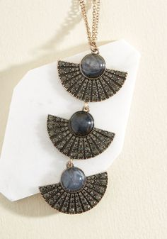 Just a Twinkle Necklace. Your ensemble doesnt need much to stand out, but wearing this pendant necklace really takes it to the next level! #black #modcloth