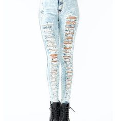 Waist-high ripped jeans;Rad skinny jeans featuring a DARK acid wash, distressed detailing on both legs, and HIGH waist. SUPER stretchy and comfy with an elastic waist. Zip closure. Faux front pockets and usable back pockets. Looks amazing paired with a crop top, and heels!