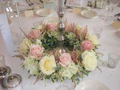 Floral base on candelabra