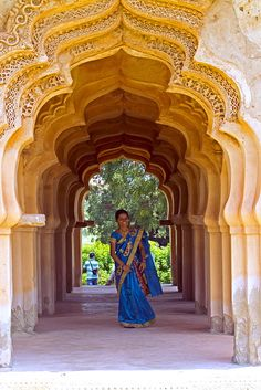 woman at lotus mahal, hampi, india