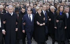 French President Francois Hollande led world leaders and French citizens for a   massive rally for unity and freedom of expression in Paris to honour 17   victims of three days of extremist attacks