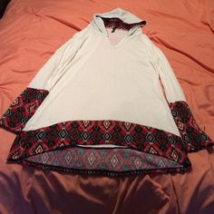 Tribal Detail Hoodie Tunic Ivory color. Has a slight v-neck. Brand new. Bought online, so it does not have tags. Never worn. Perfect condition. Super cute. Comfortable, but stylish. 63% Polyester. 34% Rayon. 3% Spandex. Tops Tunics