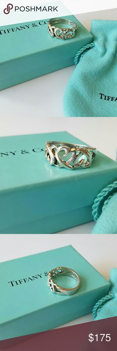 Authentic Tiffany & Co. Loving Heart Ring Silver Tiffany Loving Heart ring by Paloma Picasso. Excellent condition. Very minor scratches on inner band. Makes a beautiful gift! Comes with original box and jewelry bag. Tiffany & Co. Jewelry Rings
