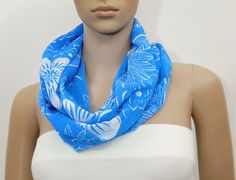 Blue infinity scarf with white floral print. Size/Dimensions Circular Loop - 57.5 inch width - 15 inch Scarf is stitched in a double layered tube form so no visible seams or unfinished raw fabric edges. Continuous loop allows you to stylize it in many different styles. A feminine, one of a kind scarf which will adorn your outfit. It is a versatile, stylish scarf and can be used as an accessory, neck wrap etc. This scarf is made of lightweight, soft fabric and will accentuate any outfit. ...