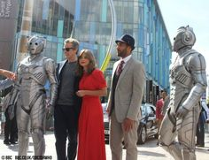 Peter Capaldi, Jenna Coleman and Samuel Anderson are flanked by Cybermen at this morning's #DoctorWho launch!