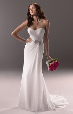 Style: Tori  Description: Perfect for the bride looking for a getaway wedding is this Paris Chiffon sheath. Sparkling Swarovski crystals dazzle against a destination backdrop. Finished with soft sweetheart neckline and signature corset back closure.   Available Colours: White, Ivory (shown)