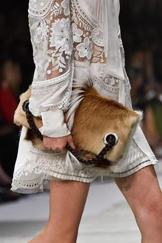 ROBERTO CAVALLI: It doesn't get more luxe that this calf-hair bag that was on the runway at Roberto Cavalli for spring.