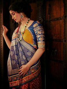 Half n half Bandhani saree with ochre yellow and cobalt blue zardozi work blouse Saree Blouse Neck Designs, Saree Blouse Patterns, Choli Designs, Designer Blouse Patterns, Fancy Blouse Designs, Stylish Blouse Design, Indian Designer Outfits, Bandhani Saree, Lehenga Saree