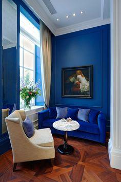 Blue Velvet Sofa Against Blue Wall via Vogue
