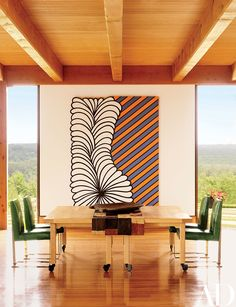 Look Inside an Art-Filled Country Home in New York Photos | contemporary rustic residential interior | Architectural Digest | interior design ideas | oversized large abstract painting artwork | modern dining rom with dining table | high ceiling with wooden beams | mountain house \ home