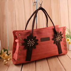 Ayumu, ladies fashion red satchel #handbag, red #satchel design, top double handles, 1 x main compartment with zip closure, interior 1 zip pocket, 1 mobile phone pocket, external zip pocket on the rear, flower ornamentl at the front. $56.00